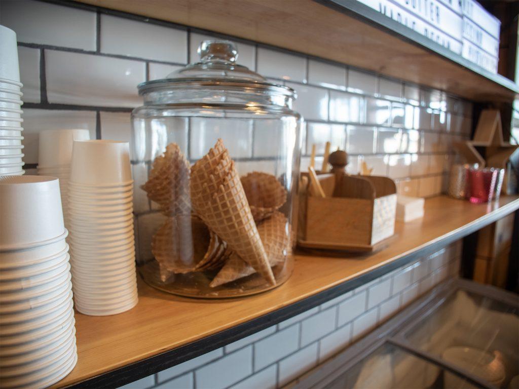 Shelf of ice cream cones and cups