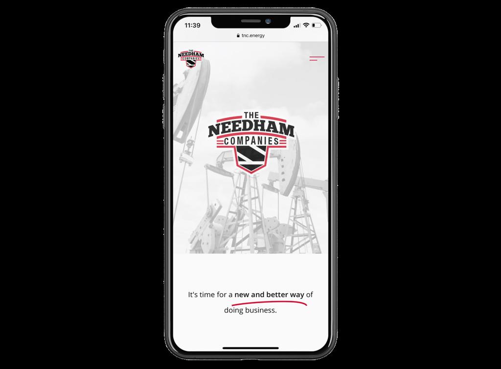 needham companies website on a phone